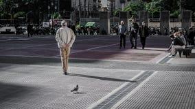 An old man walks next to the Teatro Colón royalty free stock photos