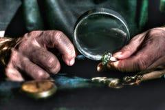 Old man watching jewelery Royalty Free Stock Photos