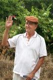 Old man waving. Chinese old man waving & smiling Royalty Free Stock Photo