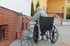 Old Man in a wheelchair Stock Image