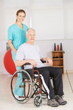 Old man in wheelchair with geriatic nurse Stock Images