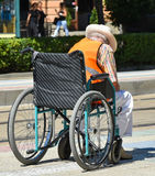 Old man in a wheelchair Royalty Free Stock Photo