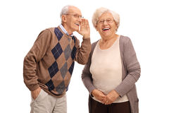 Old man whispering something to his wife Royalty Free Stock Photos