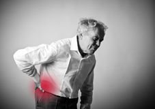 Old man is having a back pain. Royalty Free Stock Photography