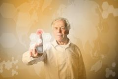 Old man in white pushing the button. Innovative technology conce. Old man in white is pushing the virtual hexagonal button. Innovative technology concept Royalty Free Stock Image