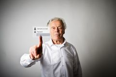 Old man is pushing the virtual button. Login and password concept. Old man in white is pushing the virtual button. Login and password concept stock photography