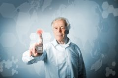 Old man in white pushing the button. Innovative technology conce. Old man in white is pushing the virtual hexagonal button. Innovative technology concept Royalty Free Stock Photography