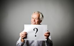 Old man in white and question mark. Royalty Free Stock Photo