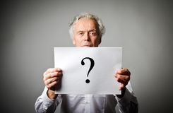 Old man in white and question mark. Stock Photography