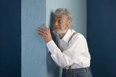 Old man with a white shirt has placed his hand Stock Photo