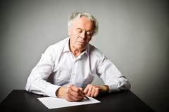 Old man is writing. stock image. Image of creative, portrait