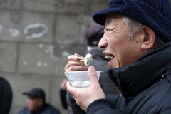 The old man who eats yuanxiao. royalty free stock photography