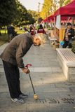 An old man writing Chinese calligraphy in the park royalty free stock photo