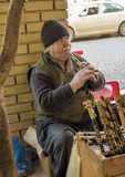 Old man with wind music instrument royalty free stock photography