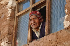 Old man at the window in Peru Stock Photos