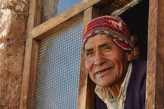 Old man at the window in Peru Stock Photography