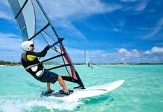Old man windsurfing on Bonaire. Old man is enjoying exhilarating run on windsurfing board, Dutch Antilles, Caribbean islands Royalty Free Stock Photos