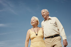 Old man and woman contemplating the sky Stock Image