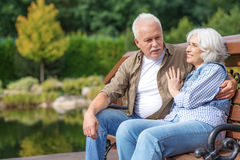 Old man and woman dating in nature Stock Image