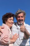 Old man and woman embracing Stock Photo