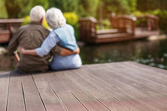 Old man and woman embracing in nature Stock Image