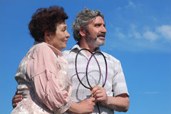 Old man and woman holding badminton rackets Stock Images