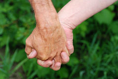 Old man and woman in love. With interlaced hands Stock Photo