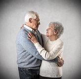 Old man and woman loving each other Royalty Free Stock Images