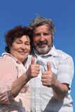 Old man and woman making thumbs up gesture Royalty Free Stock Image