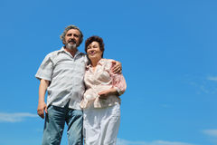 Old man and woman standing and embracing Royalty Free Stock Image