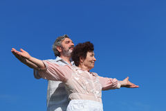 Old man and woman standing, hands apart Stock Photos