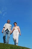 Old man and woman standing on hill Stock Photography