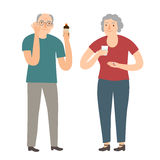 Old man and woman taking pills Stock Image