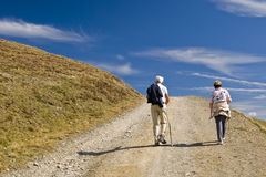 Old Man and Woman Trecking Stock Photography