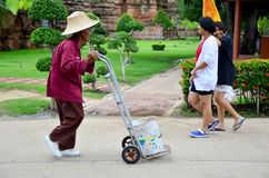 Old man working keep garbage at Wat Yai chaimongkol Royalty Free Stock Image