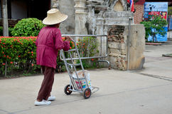 Old man working keep garbage at Wat Yai chaimongkol Royalty Free Stock Photos