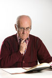 Old man works with documents Royalty Free Stock Image