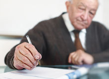 Old man write Royalty Free Stock Images
