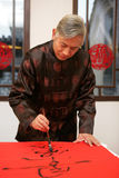 A old man writing Chinese couplet Royalty Free Stock Photo