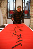 A old man writing Chinese couplet Royalty Free Stock Photos