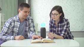 Man and young woman, married couple, use voice assistant. 30 old man and young woman, married couple, use voice assistant