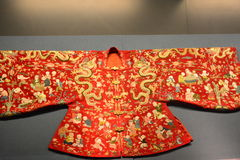 Old Manchu clothes. The ancient Manchu clothing exquisite workmanship, the embroidery surface dragon characters and various decorations, vivid image, the Qing Stock Image