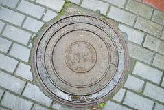 Old manhole Stock Images