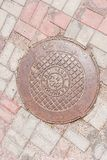 Old manhole in Kaliningrad. Russia Royalty Free Stock Images