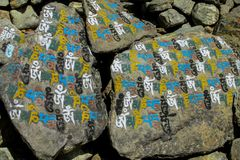 Mani Stones with Buddhist mantra Om mani padme hum in Himalaya, Nepal. Old Mani Stones inscribed with a Buddhist mantra in the Himalaya region, Nepal and Tibet stock images