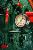 Old manometer. Manometer in old engine on the green wall Stock Photography