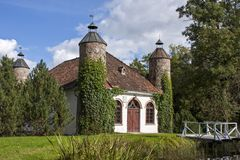 Old manor dairy house with towers in Heimtali. Old dairy house in Heimtali manor, Estonia. Built 1858 stock photography