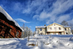 Old manor house in a snowy winter scenery Royalty Free Stock Photos