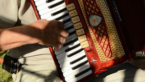 Old mans hands playing with vintage accordion Royalty Free Stock Images