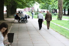 Old mans walk on the park. Two old mans walk on the park Stock Image